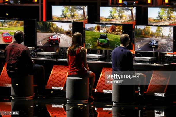 Attendees play the Forza Horizon 4 video game during the Microsoft Corp. Xbox event ahead of the E3 Electronic Entertainment Expo in Los Angeles,...