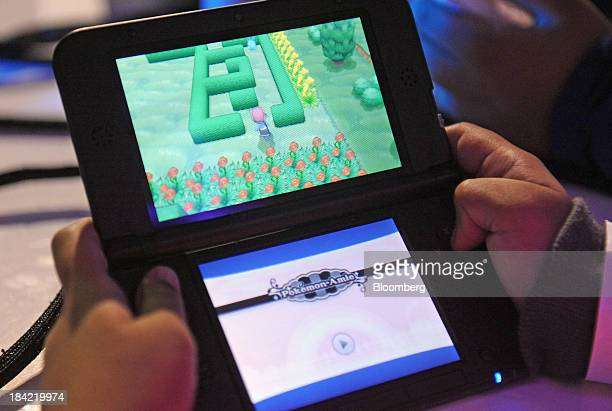 Attendees play the new Pokemon X and Pokemon Y video games on the Nintendo Co 3DS at a launch event in New York US on Friday Oct 11 2013 Nintendo...