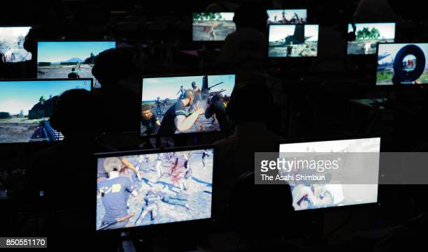 Attendees play the Player Uunknown's Battlegrounds video game during an e-Sports event as a part of the Tokyo Game Show 2017 at Makuhari Messe on...