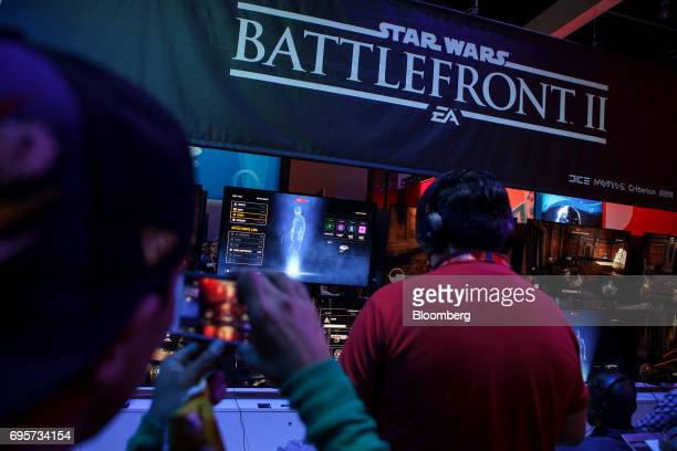 Attendees play the 'Star Wars Battlefront II' video game by Electronic Arts Inc during the E3 Electronic Entertainment Expo in Los Angeles California...
