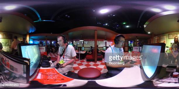 Attendees play the 'Wolfenstein II The New Colossus' video game by Bethesda Softworks LLC inside a mock diner at the company's booth during the E3...