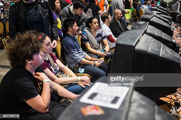 Attendees play various classic video games at MAGfest 13 in National Harbor Md on January 24 2015 MAGfest is an annual convention held in the...