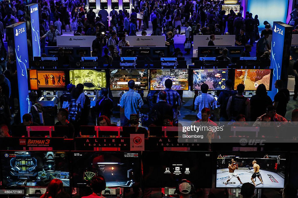 Attendees play video games on Sony PlayStation 4 (PS4) consoles during the E3 Electronic Entertainment Expo in Los Angeles, California, U.S., on Wednesday, June 11, 2014. E3, a trade show for computer and video games, draws professionals to experience the future of interactive entertainment as well as to see new technologies and never-before-seen products. Photographer: Patrick T. Fallon/Bloomberg via Getty Images