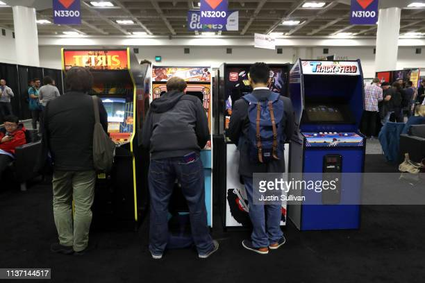 Attendees play vintage video games at the 2019 GDC Game Developers Conference on March 20 2019 in San Francisco California The GDC runs through March...
