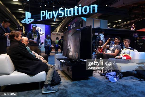 Attendees play with Sony PlayStation games at the PlayStation booth at the 2019 GDC Game Developers Conference on March 20 2019 in San Francisco...