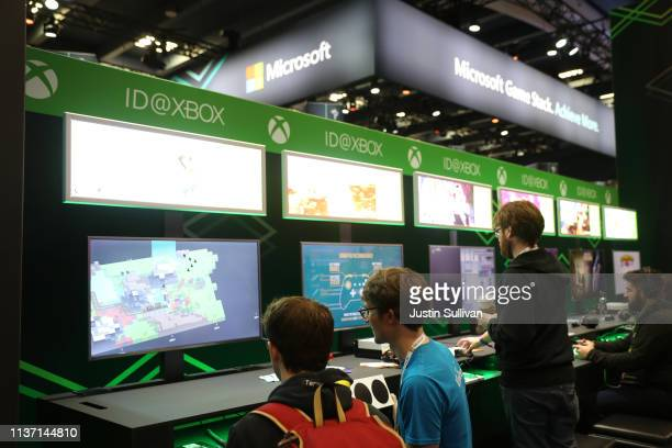 Attendees play with the Microsoft Xbox at the Microsoft booth at the 2019 GDC Game Developers Conference on March 20 2019 in San Francisco California...