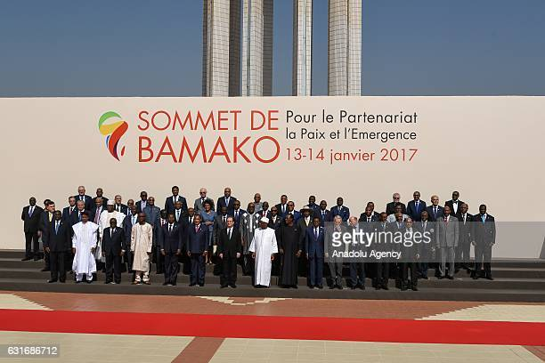 Attendees pose for a photo ahead of the 27th AfricaFrance Summit with the 'Partnership Peace and Emergence theme at the International Congress Center...