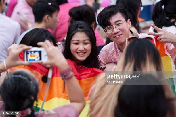 Attendees pose for a photo during the Pink Dot event held at the Speaker's Corner in Hong Lim Park on June 29 2019 in Singapore
