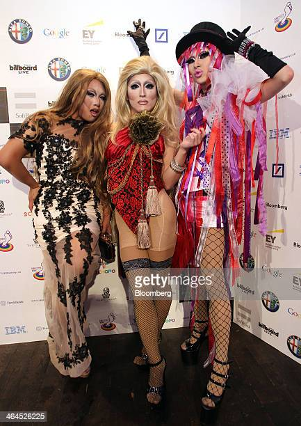 Attendees pose for photographers at the Tokyo SuperStar Awards 2013 a gala to recognize contributions to the lesbian gay bisexual and transgender...