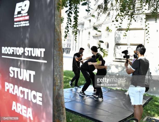 Attendees practice stunt fight sequence at the F9 Fest event on the Universal Studios backlot celebrating F9: The Fast Saga on September 15, 2021 in...