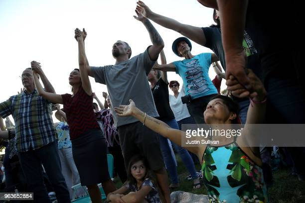 Attendees pray during Franklin Graham's 'Decision America' California tour at the Stanislaus County Fairgrounds on May 29 2018 in Turlock California...