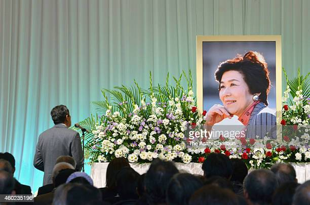 Attendees pray for late politician Takako Doi during a farewell ceremony on December 9 2014 in Nishinomiya Hyogo Japan