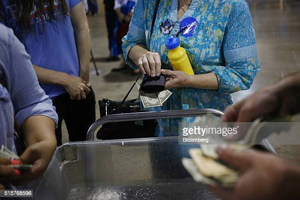 Attendees purchase bottled water during a campaign event for Senator Bernie Sanders an independent from Vermont and 2016 Democratic presidential...