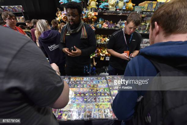 Attendees purchase Pokemon merchandise at the Pokemon European International Championships at ExCel on November 17 2017 in London England Thousands...