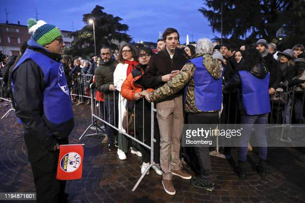 Attendees queue to take selfie photographs with Matteo Salvini, leader of the League party, during a campaign rally in Maranello, Italy, on Saturday,...