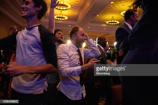 Attendees react during an election night rally for Senatorelect Jacky Rosen a Democrat from Nevada not pictured in Las Vegas Nevada US on Tuesday Nov...