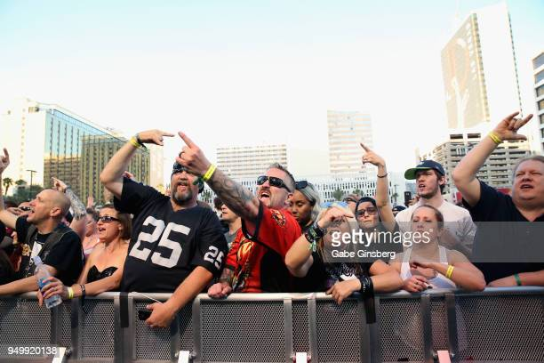 Attendees react to Adelitas Way's performance during the Las Rageous music festival at the Downtown Las Vegas Events Center on April 21 2018 in Las...