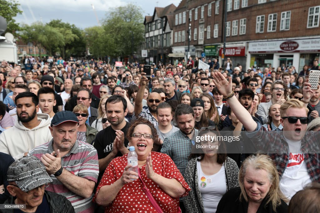 Attendees react while listening to Jeremy Corbyn, leader of the U.K. opposition Labour Party, speak during a general-election campaign rally in Watford, U.K., on Wednesday, June 7, 2017. The prime minister Theresa May and Corbyn, set out on whistle-stop tours of the country ahead of Thursday's vote, with polls all showing May's Conservatives ahead but disagreeing about whether the race is close.r. Photographer: Simon Dawson/Bloomberg via Getty Images