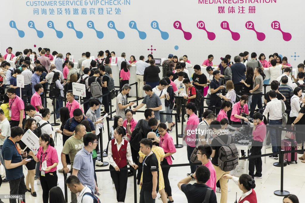 Attendees register for entrance to the CES Asia 2018 show in Shanghai, China, on Wednesday, June 13, 2018. The show runs through June 15. Photographer: Qilai Shen/Bloomberg via Getty Images