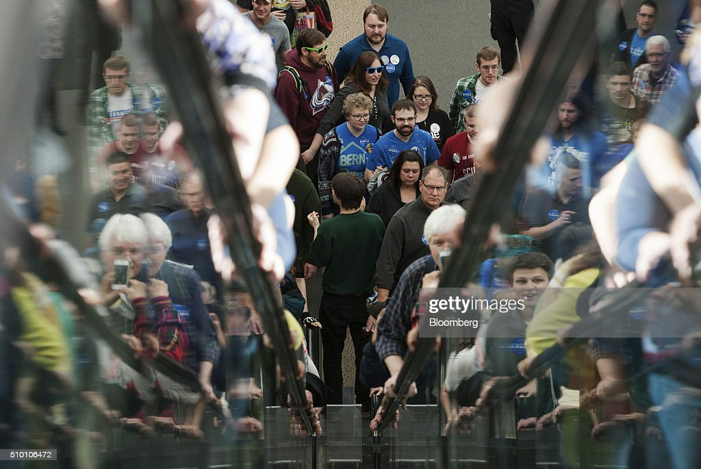 Attendees ride escalators as they enter a campaign event for Senator Bernie Sanders, an independent from Vermont and 2016 Democratic presidential candidate, at the Colorado Convention Center in Denver, Colorado, U.S., on Saturday, Feb. 13, 2016. In the first Democratic debate on Thursday since her crushing defeat in New Hampshire, Hillary Clinton tried a new approach to win back wavering supporters, capturing Bernie Sanders anger without looking angry. Photographer: Matthew Staver/Bloomberg via Getty Images