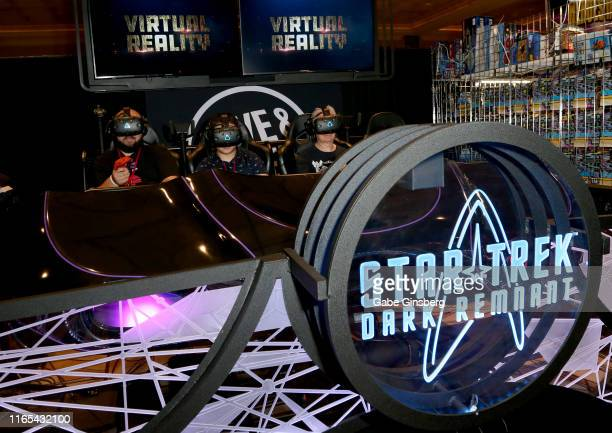 Attendees ride the Dave & Busters exclusive virtual reality ride during the 18th annual Official Star Trek Convention at the Rio Hotel & Casino on...
