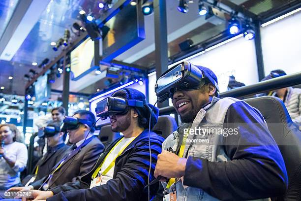 Attendees ride the Samsung Electronics Co Galaxy Gear virtual reality 4D Experience during the 2017 Consumer Electronics Show in Las Vegas Nevada US...