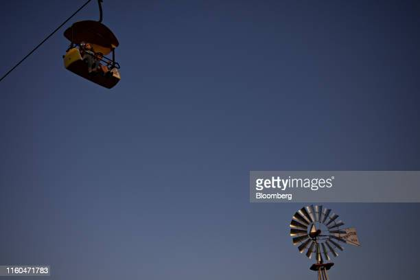 Attendees ride the Sky Glider attraction during the Iowa State Fair in Des Moines Iowa US on Thursday Aug 8 2019 The 2020 Democratic field is...
