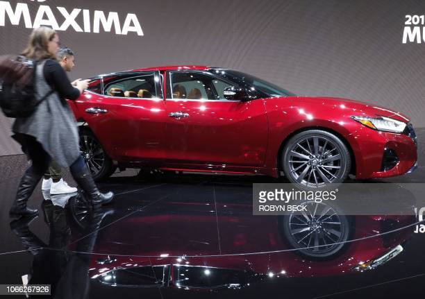 Attendees rush up to get a look at the 2019 Nissan Maxima at AutoMobility LA, the trade show ahead of the LA Auto Show, November 28 at the Los...