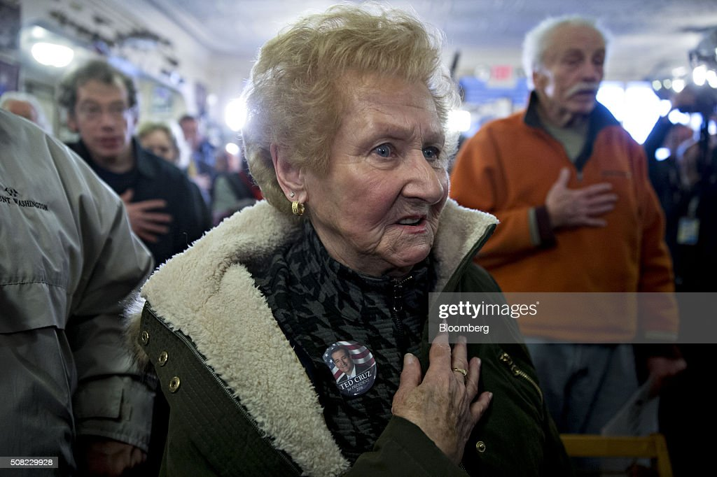 Attendees say the Pledge of Allegiance at Robies Country Store as Senator Ted Cruz, a Republican from Texas and 2016 presidential candidate, not pictured, makes a campaign stop in Hooksett, New Hampshire, U.S., on Wednesday, Feb. 3, 2016. Republican presidential candidate Donald Trump on Wednesday said Cruz 'stole' first place in the Iowa caucuses and called for 'a new election' or nullification of Cruz's win. Photographer: Andrew Harrer/Bloomberg via Getty Images
