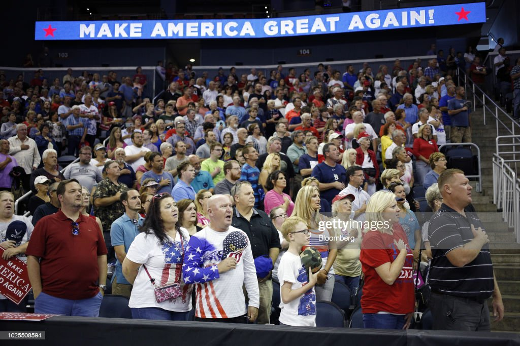 Attendees say the pledge of allegiance during a rally with U.S. President Donald Trump in Evansville, Indiana, U.S., on Thursday, Aug. 30, 2018. Trump rejected a European Union offer to scrap tariffs on cars, likening the bloc's trade policies to those of China. Photographer: Luke Sharrett/Bloomberg via Getty Images