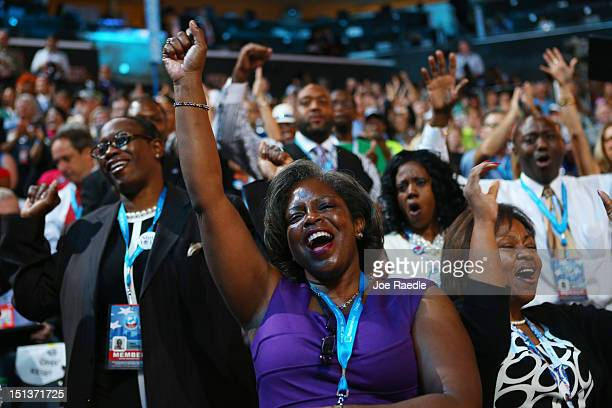 Attendees sing and dance as musician James Taylor performs on stage during the final day of the Democratic National Convention at Time Warner Cable...