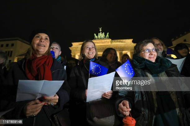 Attendees sing the Anthem of Europe during a flashmob gathering at Brandenburg Gate to mark the moment the UK left the European Union in Berlin...