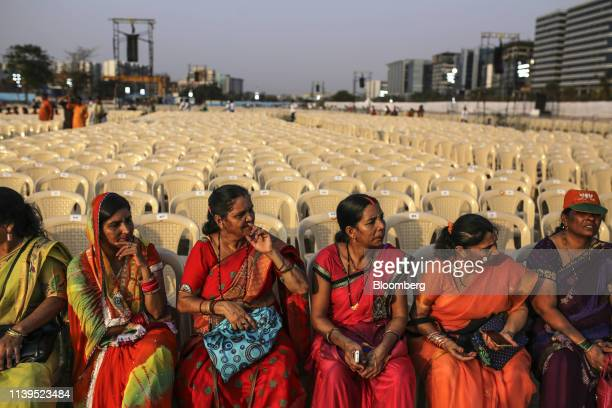 Attendees sit ahead of a rally with India's Prime Minister Narendra Modi in Mumbai India on Friday April 26 2019 Modis Bharatiya Janata Party won the...