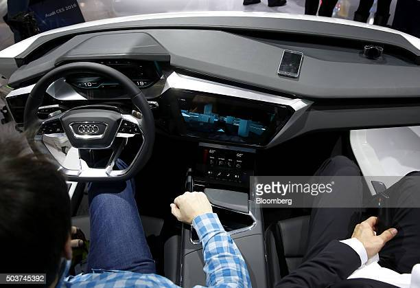 Attendees sit in the Audi AG ETron Quattro Concept vehicle during the 2016 Consumer Electronics Show in Las Vegas Nevada US on Wednesday Jan 6 2016...