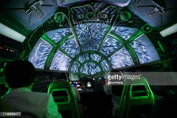 Attendees sit in the Millennium Falcon: Smugglers Run ride following the unveiling of Star Wars: Galaxy's Edge at Walt Disney Co.'s Disneyland theme...