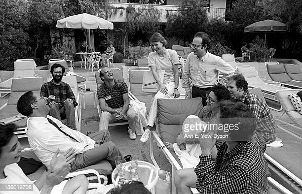 Attendees sit next to the pool at the annual PC Forum Phoenix Arizona February 1619 1986 Pictured are from left Robert Berland from IBM/deceased Dan...