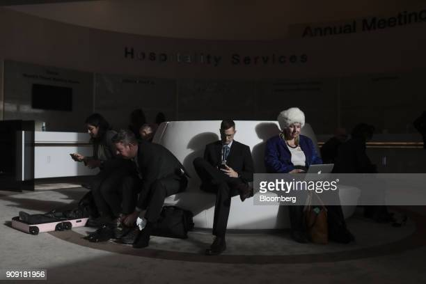 Attendees sit on a sofa in the Congress Center on the opening day of the World Economic Forum in Davos Switzerland on Tuesday Jan 23 2018 World...