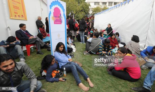 Attendees sit on the lawn as they listen to a conversation betwen Indian author Chetan Bhagat Suhel Seth and Indian MP Shashi Tharoor during the DSC...