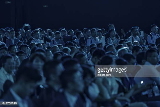 Attendees sit waiting for the keynote address at the Huawei Connect 2017 conference in Shanghai China on Tuesday Sept 5 2017 Huawei Technologies Co...