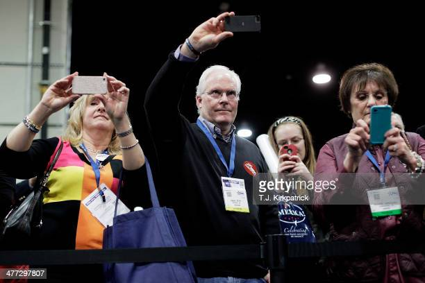 Attendees snap photos with their cell phones of conservative pundit and author Ann Coulter signing books during the 41st annual Conservative...