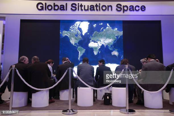 Attendees speak at the global situation space in the Congress Center on day three of the World Economic Forum in Davos Switzerland on Thursday Jan 25...