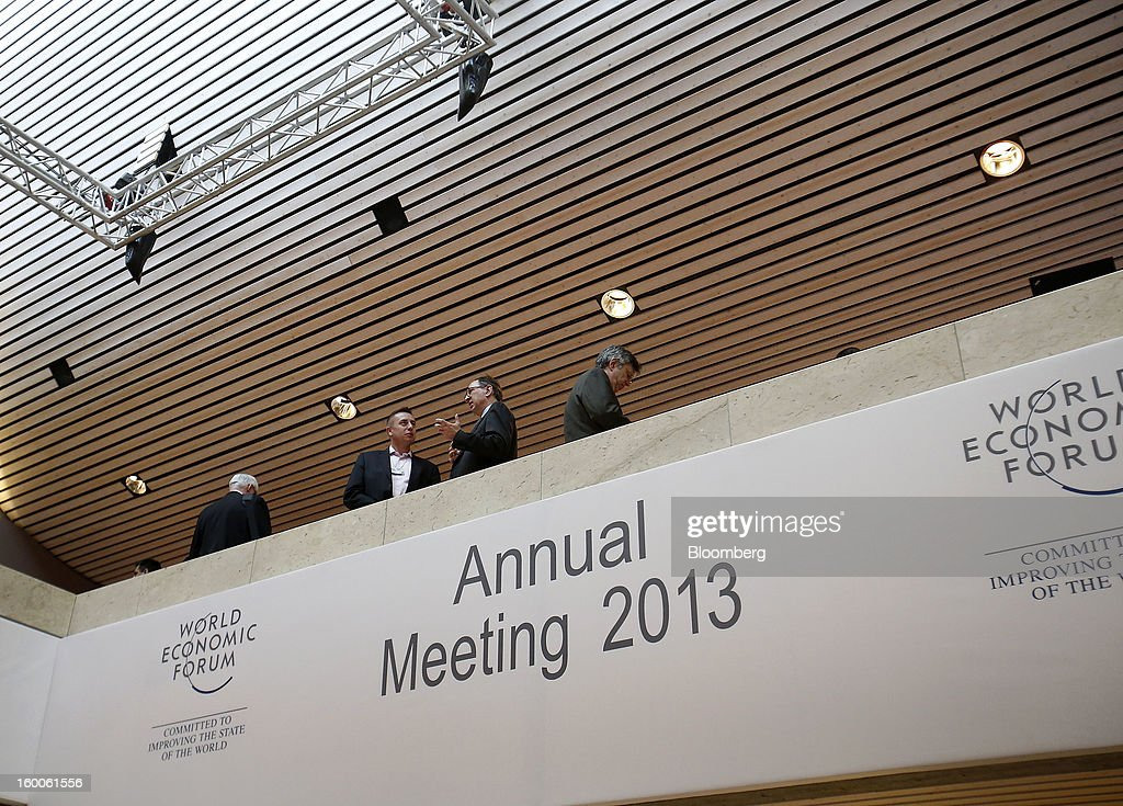 Attendees speak inside the at the Congress Center on day three of the World Economic Forum (WEF) in Davos, Switzerland, on Friday, Jan. 25, 2013. World leaders, influential executives, bankers and policy makers attend the 43rd annual meeting of the World Economic Forum in Davos, the five day event runs from Jan. 23-27. Photographer: Simon Dawson/Bloomberg via Getty Images