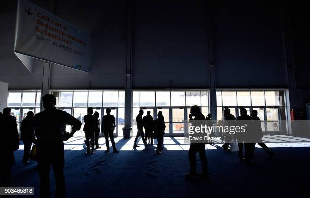 Attendees stand around after the power went out during CES 2018 inside the central hall at the Las Vegas Convention Center on January 10 2018 in Las...