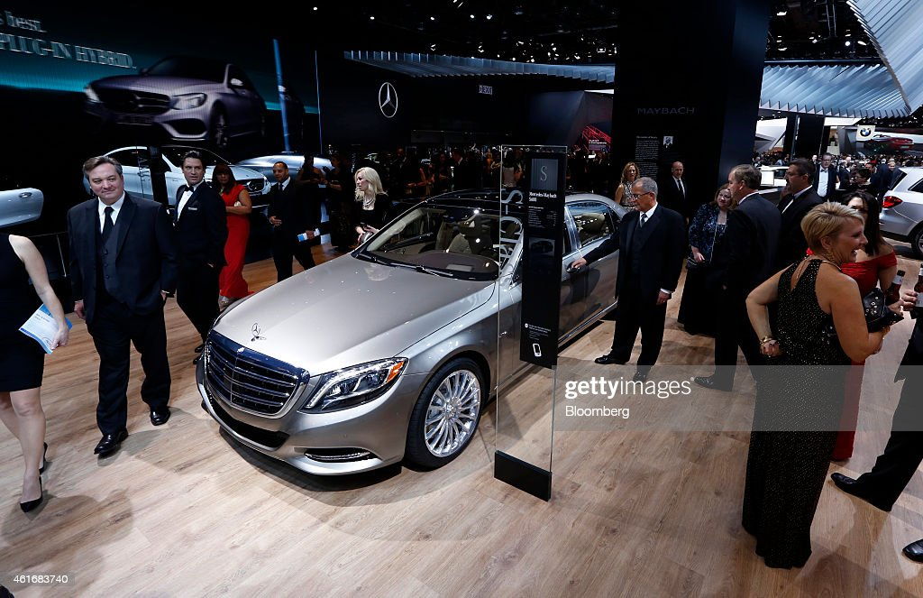 Attendees stand around the Daimler AG Mercedes-Benz Maybach S600 at the Charity Preview for North American International Auto Show (NAIAS) in Detroit, Michigan, U.S., on Friday, Jan. 16, 2015. Since 1976, the Charity Preview has raised more than $100 million for Southeastern Michigan children's charities. Photographer: Jeff Kowalsky/Bloomberg via Getty Images