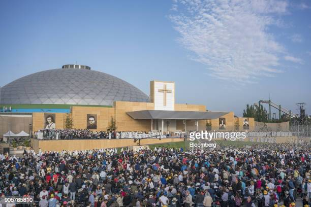 Attendees stand as Pope Francis not pictured arrives to give mass at O'Higgins Park in Santiago Chile on Tuesday Jan 16 2018 400000 Chileans attended...