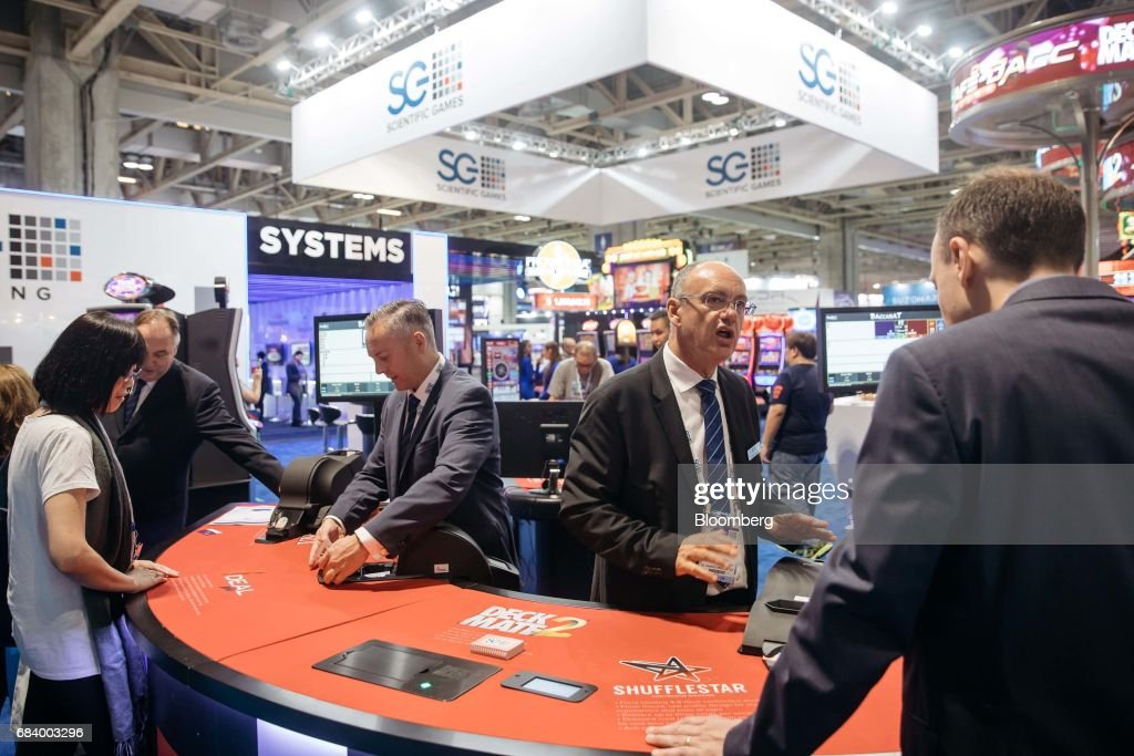 Attendees stand at a Blackjack table at the Global Gaming Expo (G2E) inside the Venetian Macao resort and casino, operated by Sands China Ltd., a unit of Las Vegas Sands Corp., in Macau, China, on Tuesday, May 16, 2017. The gaming expo runs through May 18. Photographer: Anthony Kwan/Bloomberg via Getty Images