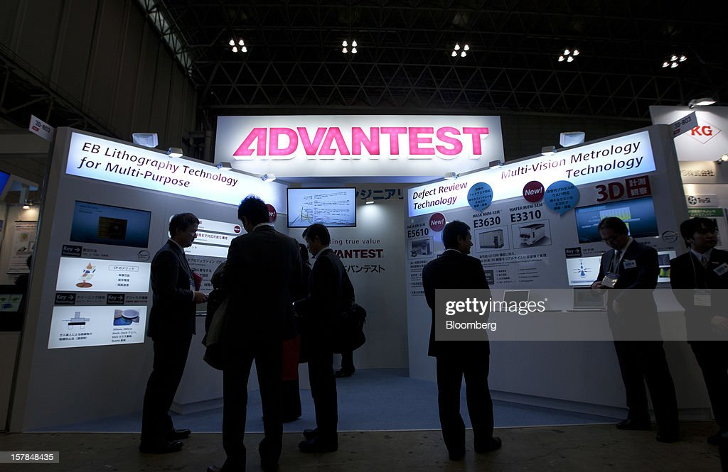 Attendees stand at the Advantest Corp. booth at the Semicon Japan 2012 in Chiba, Japan, on Friday, Dec. 7, 2012. Advantest Corp. is the world's biggest maker of memory-chip testers. Photographer: Tomohiro Ohsumi/Bloomberg via Getty Images