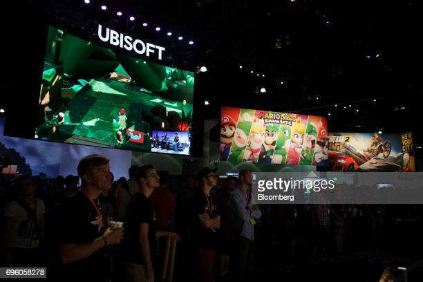 Attendees stand at the Ubisoft Entertainment SA booth during the E3 Electronic Entertainment Expo in Los Angeles California US on Wednesday June 14...