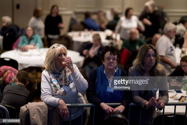 Attendees stand during an election night rally for Conor Lamb Democratic candidate for the US House of Representatives not pictured in Canonsburg...