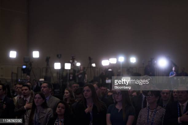 Attendees stand during the Star Spangled Banner at the Conservative Political Action Conference in National Harbor Maryland US on Friday March 1 2019...